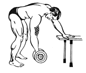 Bending of the arms with the dumbbell standing in the slope